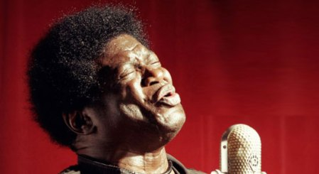 Charles Bradley at a microphone